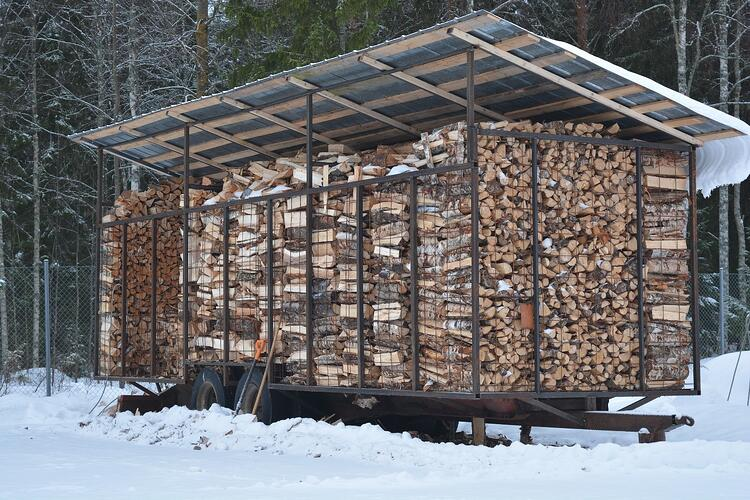 Drying firewood under a canopy in Finland.