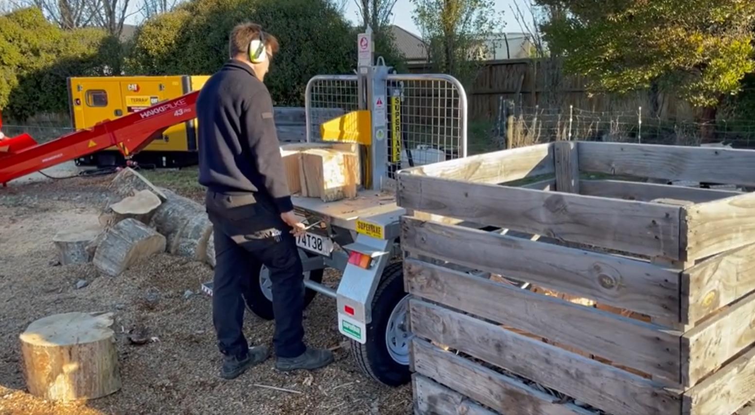 Log splitter in use alongside the firewood processor.