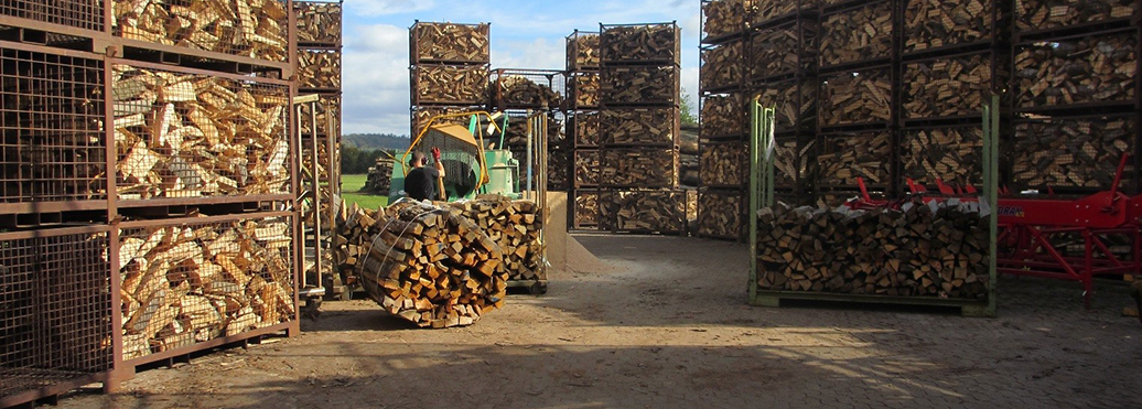 Firewood drying in log cages.